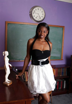 Seductive ebony babe with big boobs stripping in the class