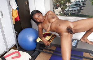 Horny ebony babe stripping and showing off her fuckable body