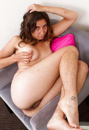 Busty babe with hairy armpits and unshaven legs slipping off her clothes