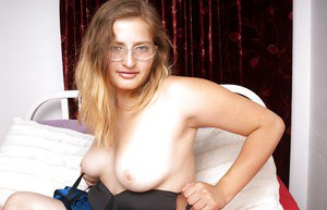 Fatty babe in glasses showing off her big tits and shaggy muff