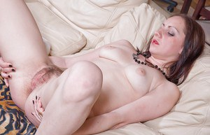 Filthy babe with big tits stripping and fingering her hairy cunt