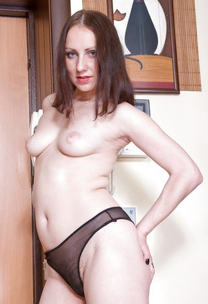Horny babe with big tits stripping and teasing her unshaven cooter