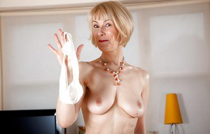 Stunning mature lady in stockings exposing her titties and hairy cunt