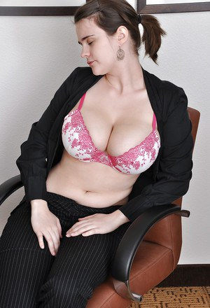 Brunette babe exposing her huge boobs and hairy twat in the office