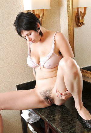 Filthy brunette babe in jeans stripping and teasing her hairy cunt