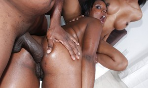 Curvaceous ebony babe Capri Stacy shares a huge cock with her friend