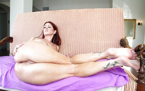 Redhead MILF Tiffany Mynx gets her asshole stretched with a big cock