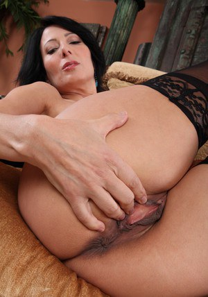 Sexy MILF Zoey Holloway stripping and fingering her trimmed pussy