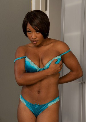 Seductive ebony MILF Imani Rose stripping and spreading her legs