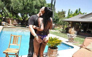 Slutty ebony babe Coffee Brown likes to suck and fuck white cock outdoor