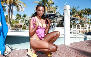 Ebony babe Tiffany Taylor stripping and fingering her pussy by the pool