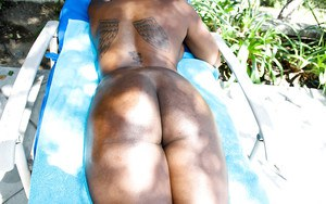 Foxy ebony MILF Tori Taylor taking off her clothes and spreading her legs