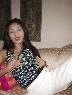 Hot thai MILF slipping off her clothes and fingering her twat