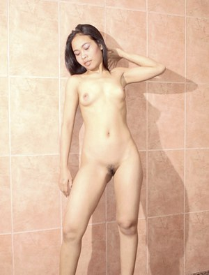 Fuckable asian babe on high heels taking off all of her clothes