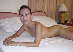 Skinny thai babe with tiny tits posing and spreading her legs
