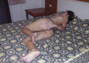 Fuckable asian babe taking off her clothes and exposing her hot ass