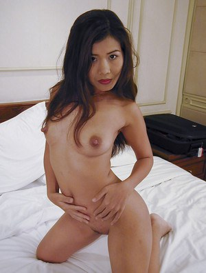 Cute asian babe with tiny tits spreading her legs and teasing her muff