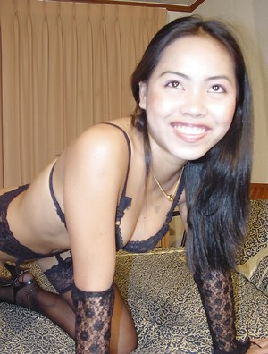 Sexy asian babe in lacy stockings teasing her trimmed cooter