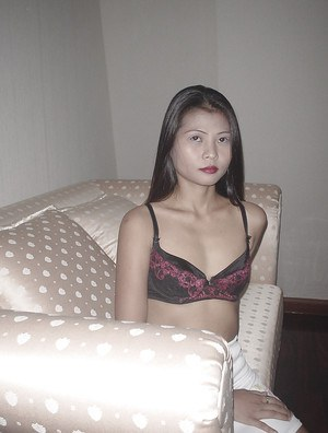 Long haired asian babe exposing her tiny tits and spreading her legs