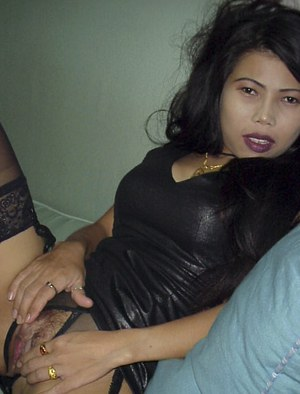 Filthy asian babe in leather dress stripping and playing with a huge toy