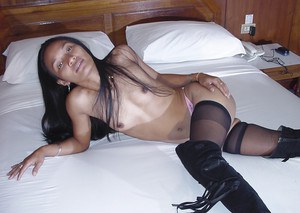 Sexy thai babe in stockings slipping off her panties and toying her cunt