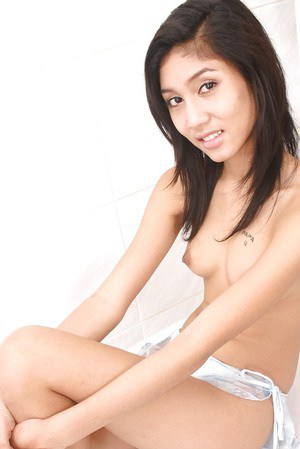 Tempting asian babe with tiny tits masturbating her bush with a jelly toy