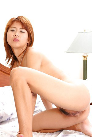 Slutty asian babe spreading her legs and toying her unshaven cunt