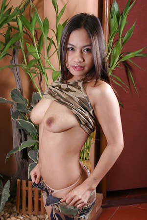 Foxy asian babe with petite jugs stripping and toying her twat