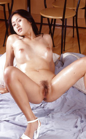 Gorgeous asian babe spreading her legs and exposing her hairy slit