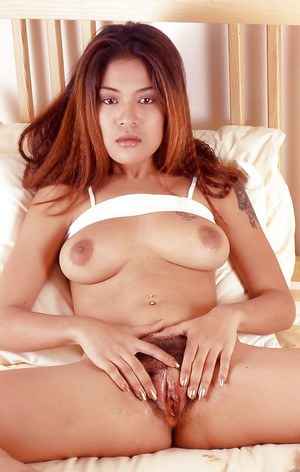 Smoking hot asian babe with big tits stripping and toying her bush