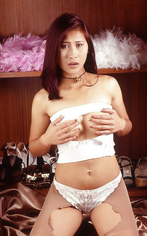 Kinky asian babe masturbating her unshaven slit and gets bounded