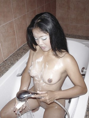 Filthy asian babe gives a blowjob and gets a huge load of jizz on her tits