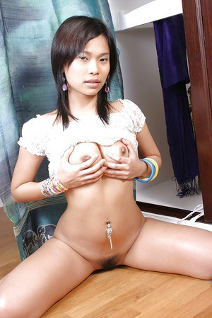 Horny asian babe stripping and masturbating her twat with various toys
