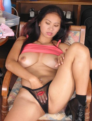 Seductive asian MILF with big tits stripping and toying her hairy cunt