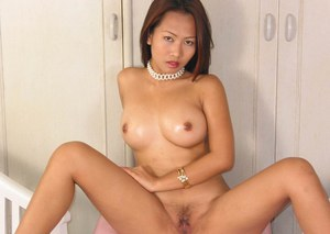 Hot asian babe uncovering her sexy curves and toying her hairy muff