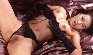 Asian hottie in black gloves exposing her nice tits and trimmed pussy