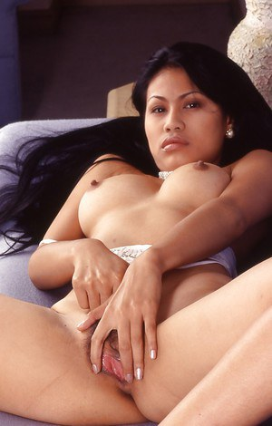 Smoking hot asian babe with big jugs stripping off her white lingerie