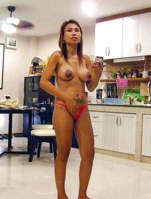 Fuckable asian babe exposing her tiny tits and unshaven cunt