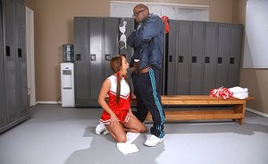 Seductive teen cheerleader sucks and fucks a big black boner