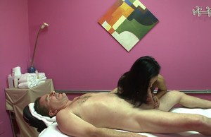 Skinny asian masseur gives a tugjob and gets fucked on the massage table
