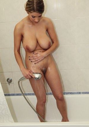 Smoking hot babe with massive natural tits taking a shower