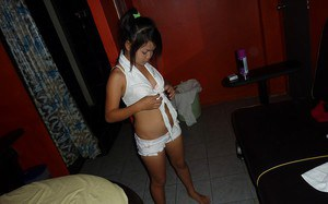 Horny asian chick Nit Noi stripping off her clothes and gets shagged