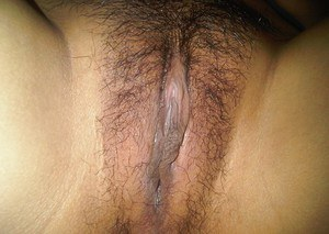 Naughty asian babe showing off her small titties and hairy pussy