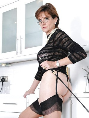 Fetish mature lady on high heels exposing her butt and twat