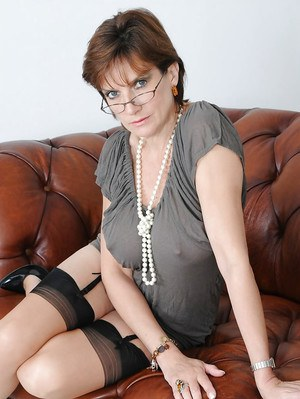 Fetish mature babe in glasses spreading her legs and fingering her cunt