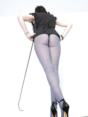 Seductive mature lady with hot ass and slender legs posing in pantyhose