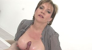 Horny mature lady gives a titjob and gets a cumshot on her boobs