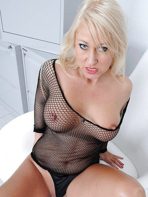 Blonde mature babe showing off her big boobs and shaved cunt