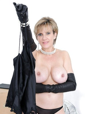 Sexy mature babe with huge boobs slipping off her black lingerie