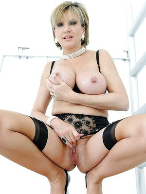 Fetish mature lady playing with her hard nipples and spreading her legs